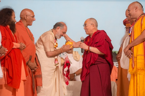 HHDL offering a buddha statue to Shri Ramesh Bhai Ojha as a birthday gift to him during the celebration
