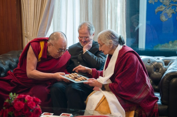 Lieutenant Governor of Delhi Sh. Najeeb Jung center and hhdl offering cookies to