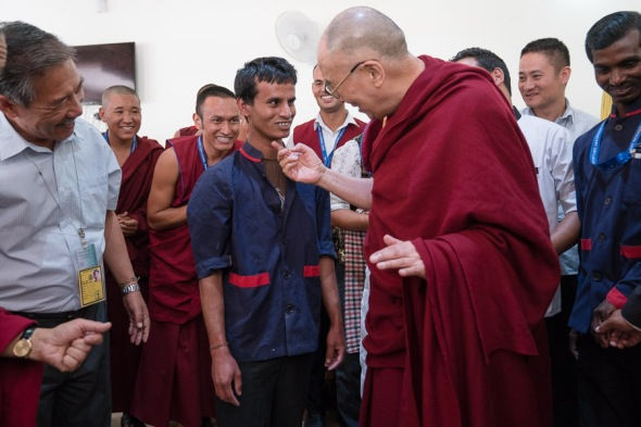 HHDL playing with a kitchen staff after the lunch