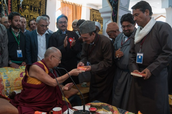 His Holiness presenting His book Ethics for the new Millenium for leaders of Shia and Sunni community in Leh